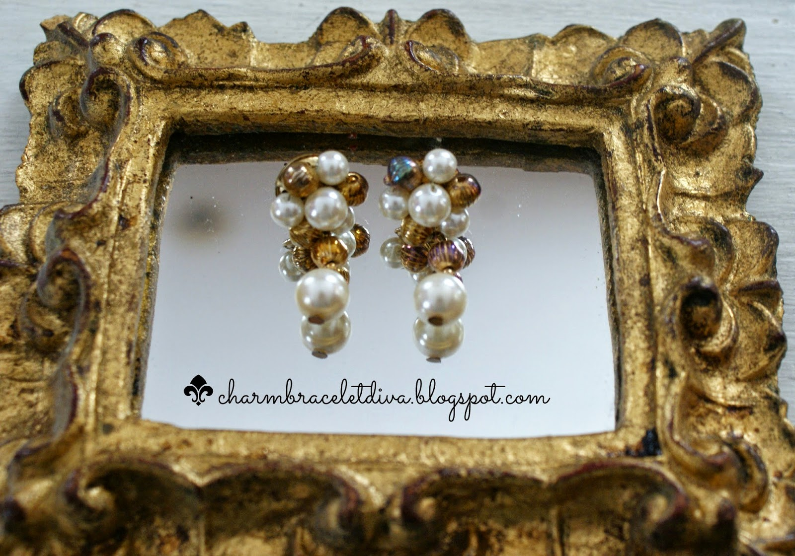 Vintage pearl and bead cluster drop earrings on mirror
