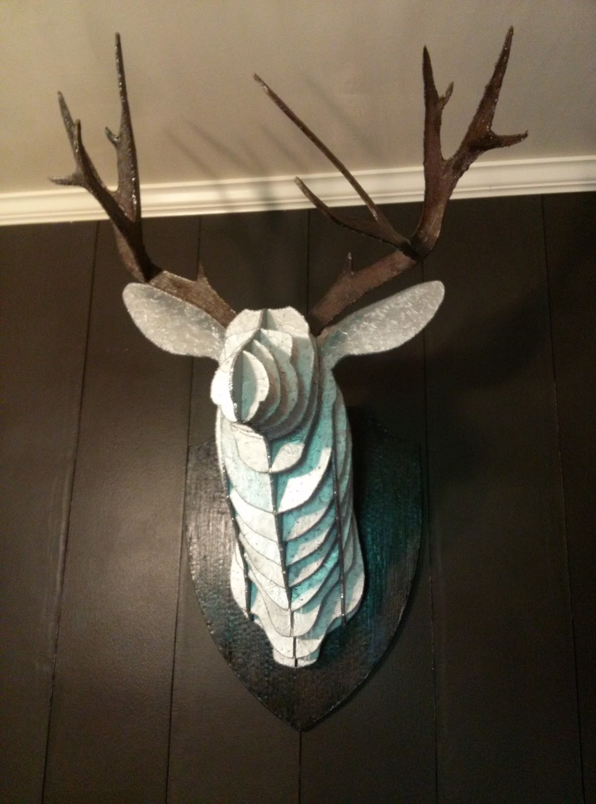 i mean seriously who want a glammed up faux deer head in their dining room