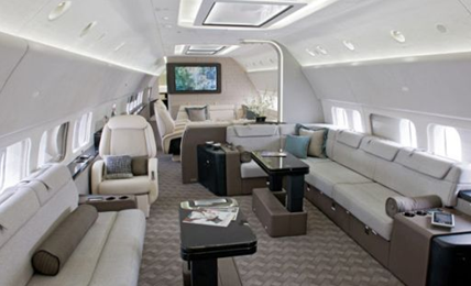 white interior cabin seats of luxury boeing business jet vip bbj private airplane