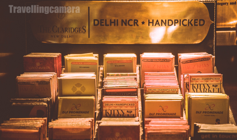 "This week The Claridges had invited few blogger for a tour of the property (at least, this is what I understood). This Photo Journey shares some of the photographs clicked through the tour of The Claridges, New Delhi.This photograph is clicked inside the famous Dhaba restaurant of Claridges. It was closed at the time we were exploring the property. It opens at 7pm for dinner.There is huge green lawn in front of the entry of The Claridges hotel. October is probably the best time to have a seat in the lawn and enjoy your drinks/food. I am not sure if it's also used during summers.This is just in front of main entry of The Claridges hotel in New Delhi. Just after the reception there is a hall with appropriate seating arrangements for guests.After high tea and some snacks, we headed towards the swimming pool area. It seemed that buffet was being setup around the pool and this setup caught my attention.When we visited the pool, there were very few folks around , but it seemed that place was getting ready for some evening party.The Claridges has a Crayon Art Gallery, which is located near reception area.The Crayon Art Gallery is adjoining the bakery (Ye Old Bakery) inside The Claridges Hotel.There are multiple restaurants at The Claridges - Sevilla, Dhaba, Pickwicks, Jade, Ye Old Bakery, Aura ...Above 2 photographs are again from Dhaba restaurant. I am sure that ""ठेका "" would have caught your attention as well.After taking a tour, we headed to one of the suites at the Claridges and had interesting chit-chat about photography, dogs, Gurgaon etc. :) ...Finally we headed towards Jade restaurant, which has very different ambiance. Jade serves authentic Chinese cuisine."