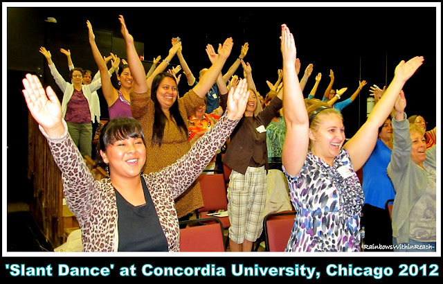 "photo of: Energetic Teachers participate in ""Slant Dance"" for Fine Motor Development"