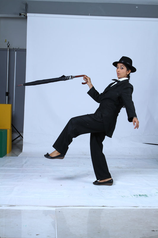 Meera Jasmine latest Photoshoot as Charlie Chaplin for Anbulla Kamal movie glamour images