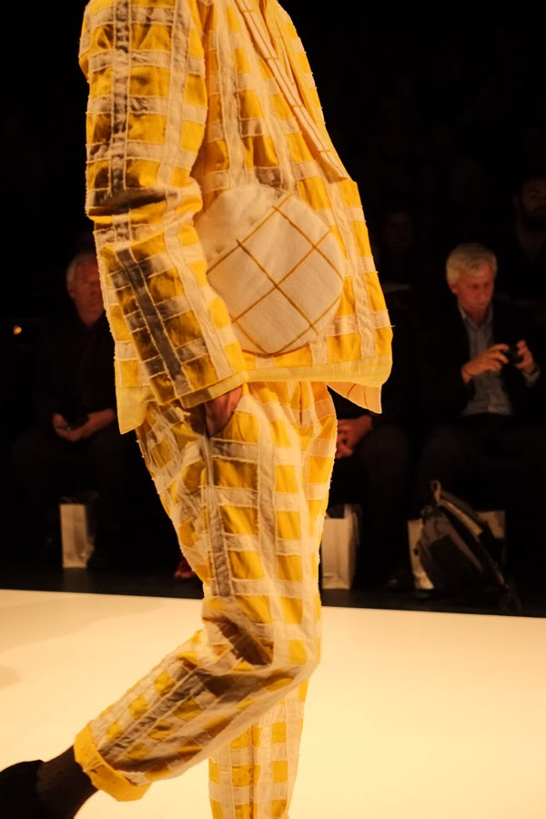 Matiny Ng; yellow and white large check pattern jacket and pants with large round pocket motif; side view - Menswear : Raffles Graduate Fashion Parade 2013 Photography by Kent Johnson.
