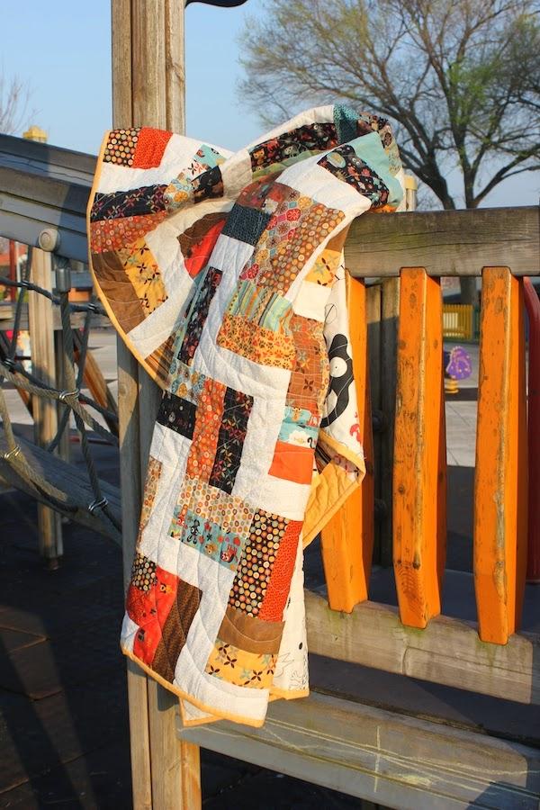 quilt de patchwork con el diseño de fence rail
