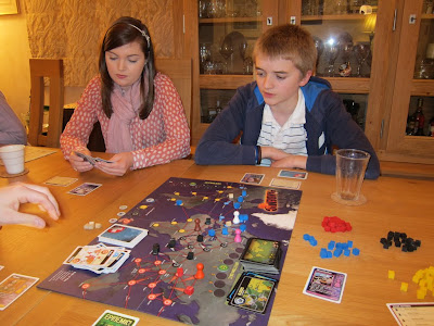 Pandemic - The players worrying about the continuing spread of viruses, although we were feeling hopeful at this point!