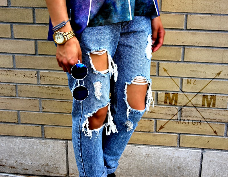 mirrored sunglasses and distressed jeans