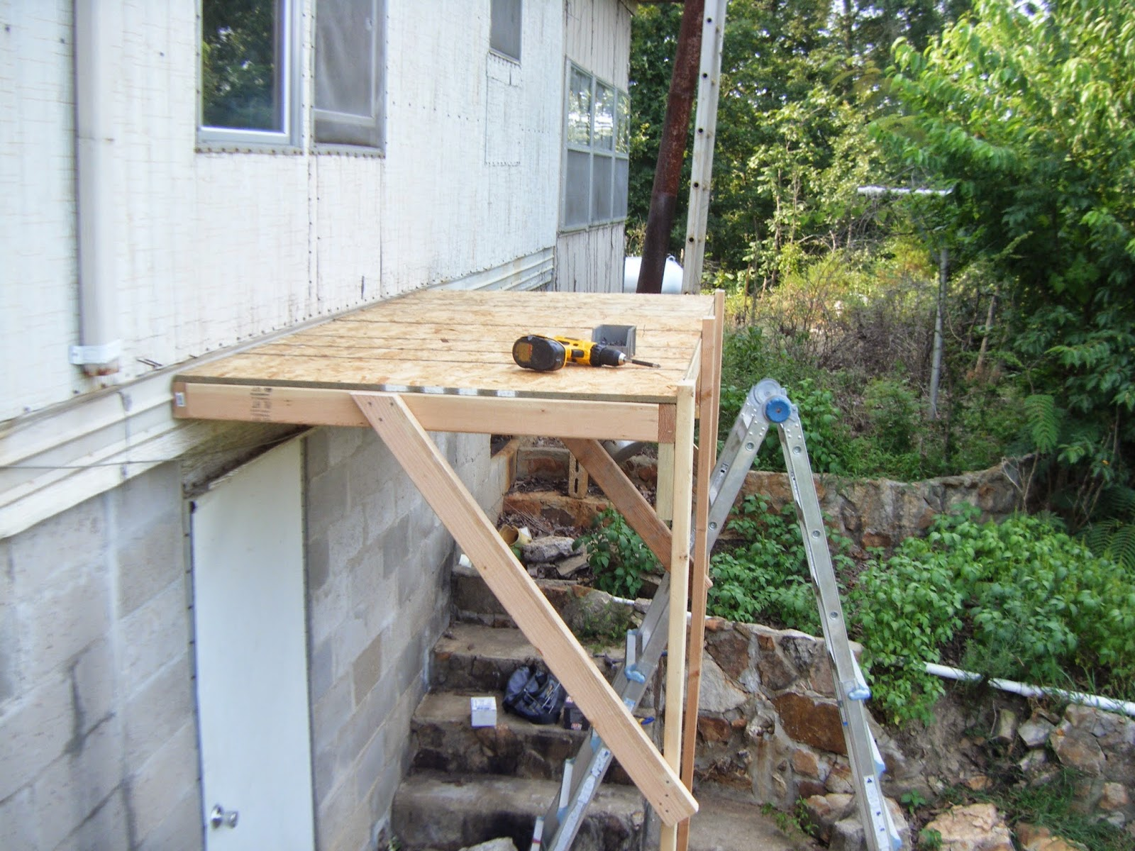 more bracing and the deck of the scaffolding in place