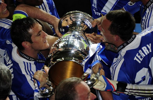 Chelsea player Frank Lampard celebrates their Champions League triumph with team-mate John Terry