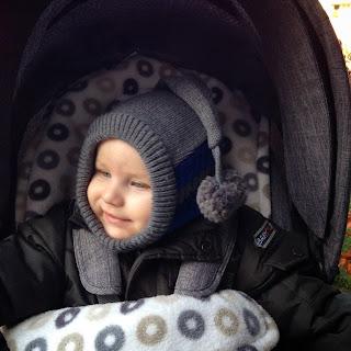Christkind im Kinderwagen