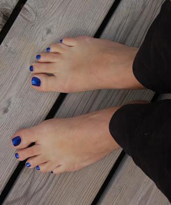 blue nail varnish, polish on a mans toes
