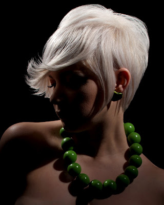 blonde model, backlit green necklace nude shoulders