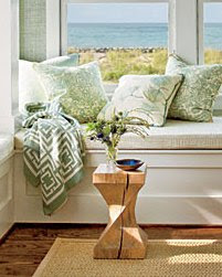 Close up of the Nbaynadamas throw in a window seat vignette with an ocean view in the Coastal Living Magazine