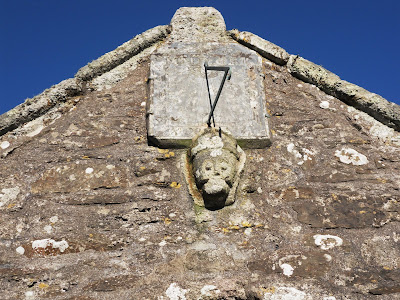figure head above St Cubys church, Tregony, Cornwall