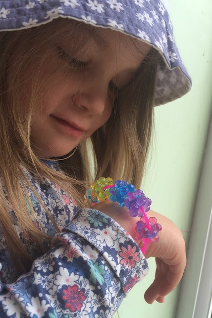 Four year old girl with the Beados Gem Designer Studio Bracelet she made.