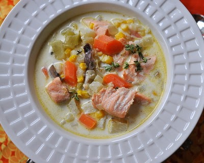 Salmon Chowder, fresh salmon in a creamy broth with carrot, potato, fennel.