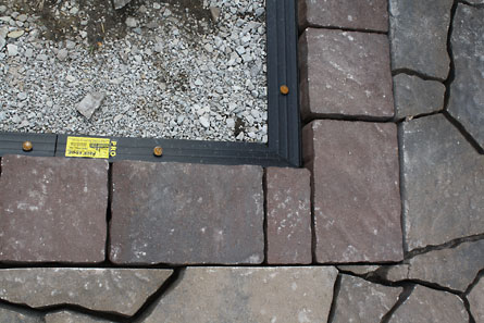 We laid the patio stone pavers first, then measured 8 inches from the  no-dig landscape and paver edging where to cut. (The boarder pavers were 8  inches that ... - How To Build A Patio {part 4}: Laying Pavers The Hansen Family