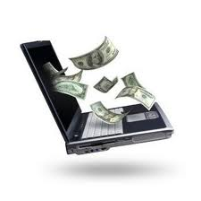 gambar uang dan komputer