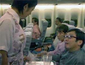 Misaki takes the passenger's drink order.