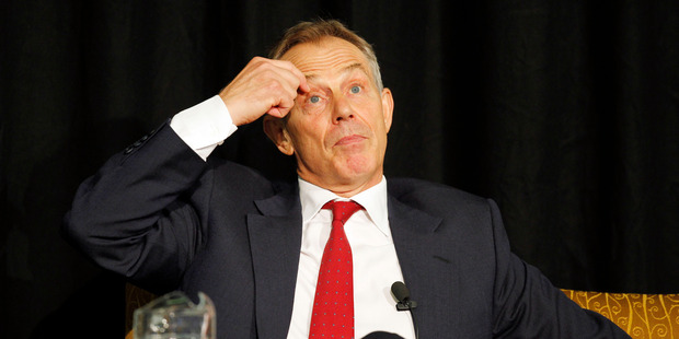 Tony Blair committed to Iraq War a year before invasion, secret memos reveal