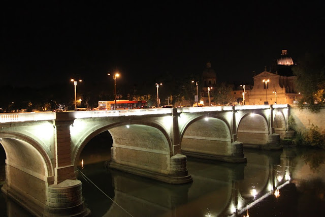 The night view of a bridge in the city of Rome, Italy