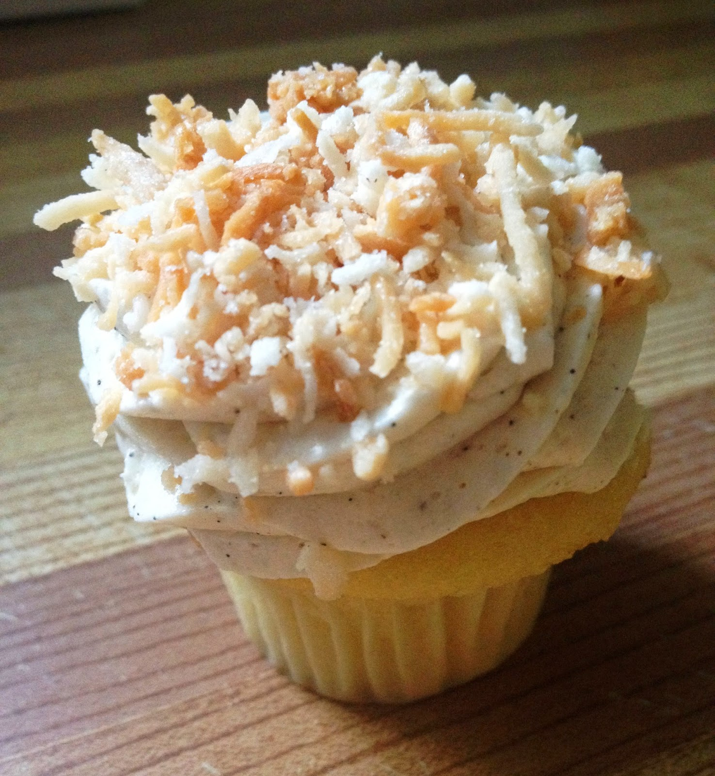 Golden Buttermilk Cupcakes with Vanilla Icing and Topped with Toasted Coconut from Prairie Girl Bakery