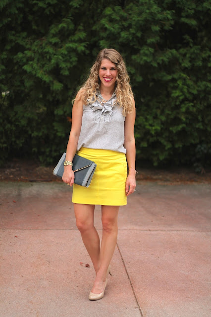 sleeveless silk grey ruffle top, yellow skirt, nude heels, grey clutch