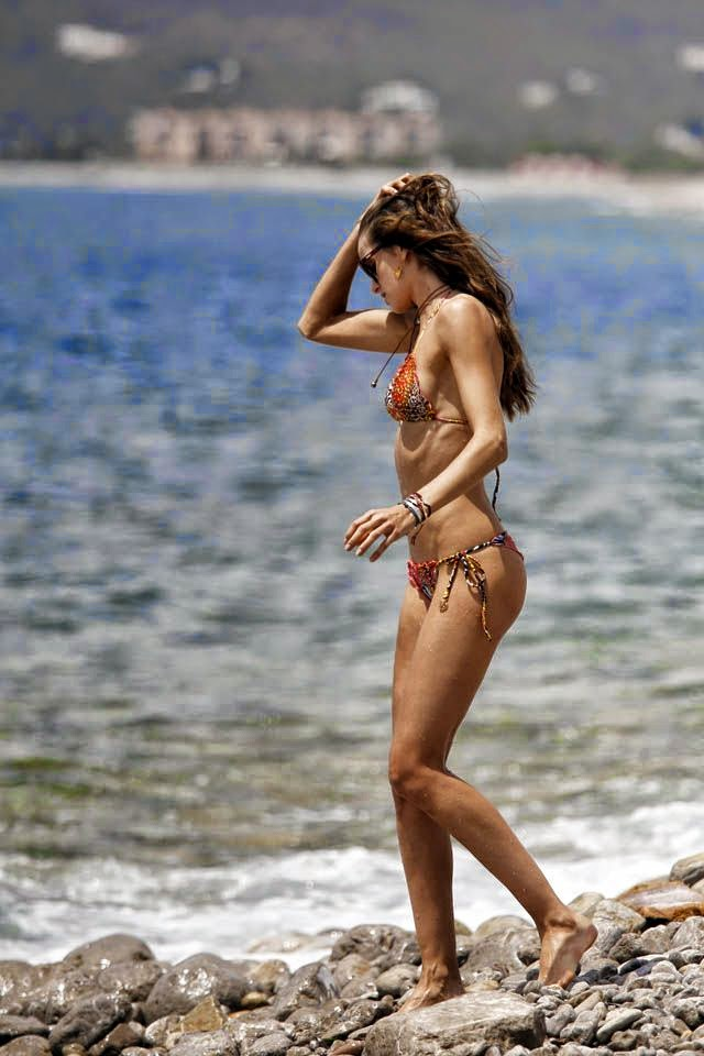In a sizzling two-piece from the greatest design of swimwear, the 29-year-old is not afraid to show off what she's get whilst at holiday in Ibiza on Monday, June 23, 2014.