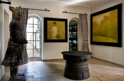 antique historical statue and foyer table accompanied by dramatic painting