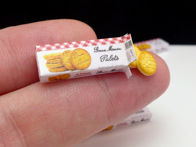 Miniature box of Bonne Maman cookies with fingers for scale