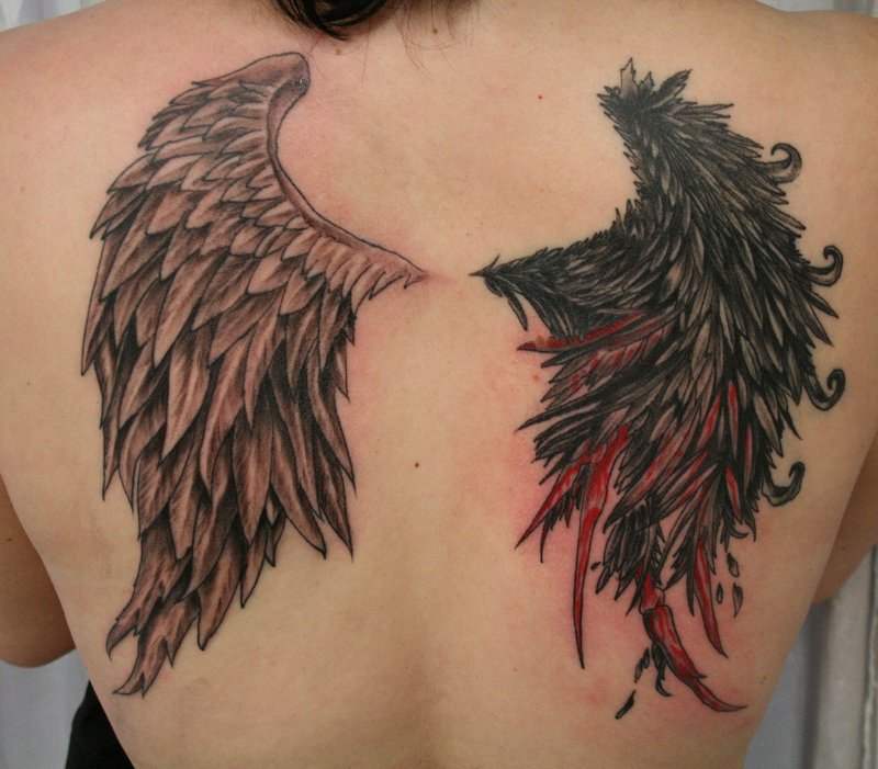 wing tattoos on back for girls. wings tattoo men