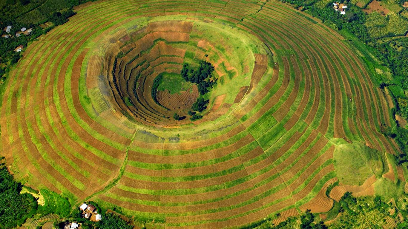 A terrace-farmed volcano near Kisoro, Uganda (© Peter McBride/Axiom) 105