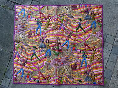 Færdig quiltet tæppe af smukt patchworkstof