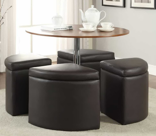 amazing circle coffee table with round shaped on top that has metal stainless steel prop and four black seat under table