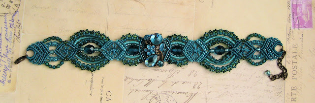 A teal micro-macrame bracelet featuring a crystal slider in my origianl design.