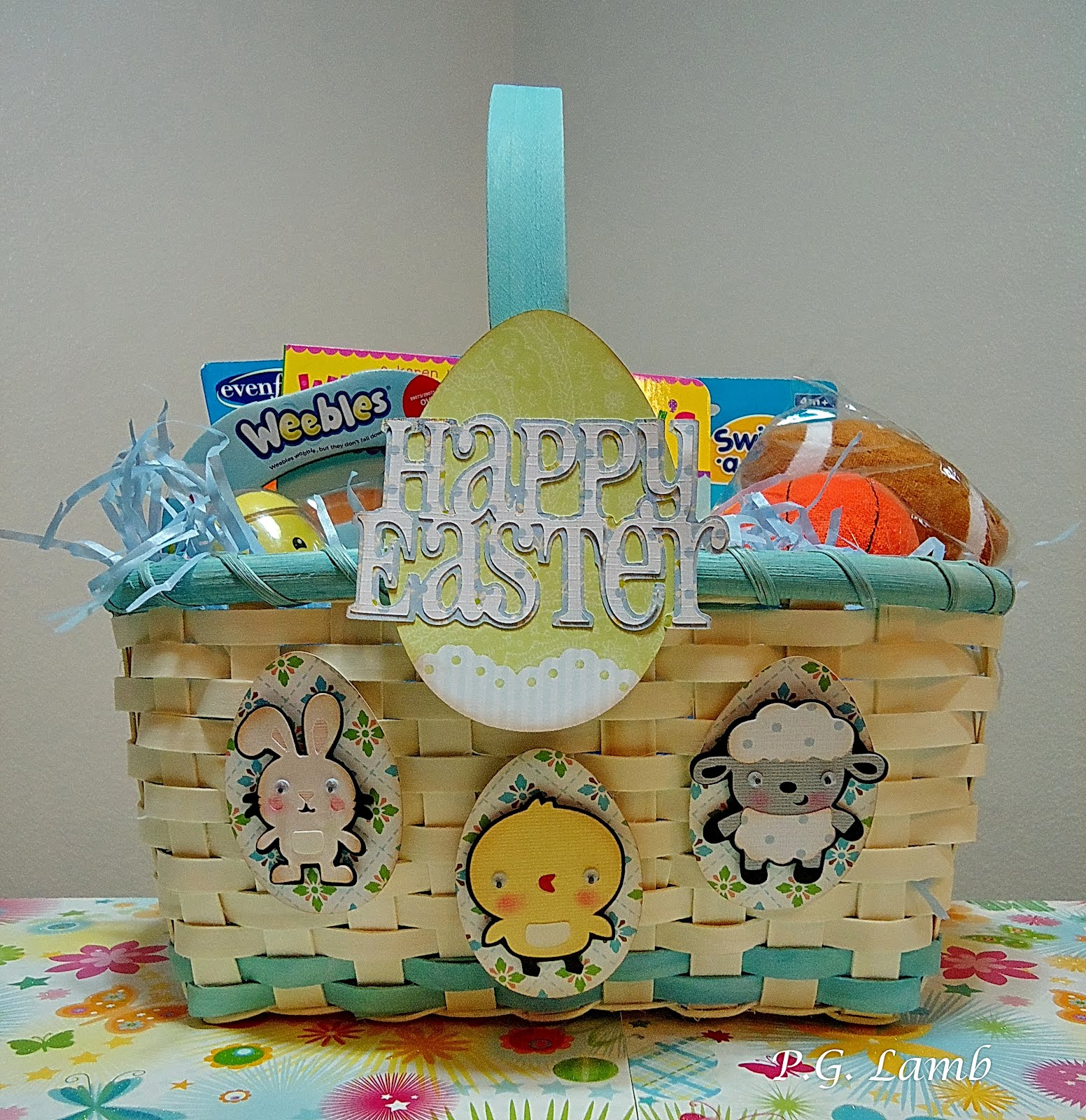 Peachy paper crafts a baby boys easter basket for those who are curious as to whats inside the basket i have a chick and bunny weebles a book with the title where are babys easter eggs negle Image collections