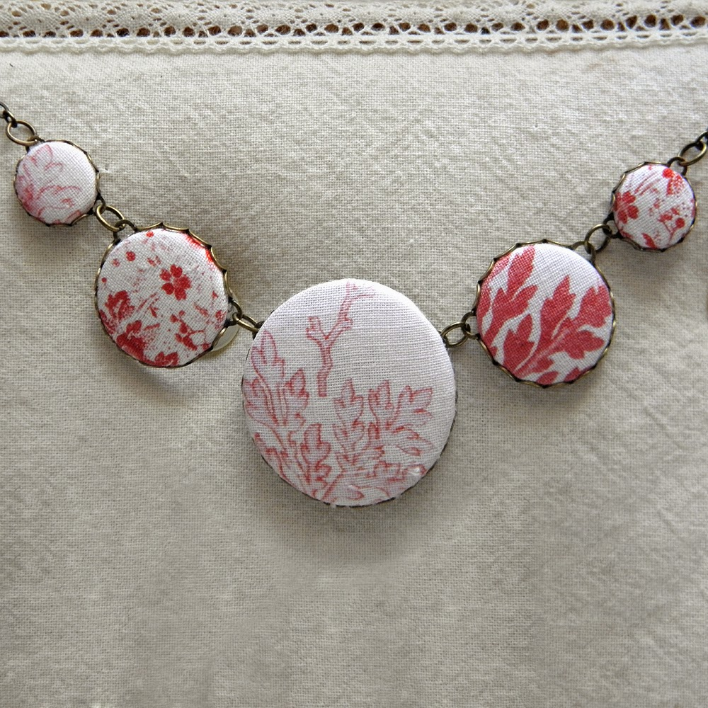 http://folksy.com/items/6420871-Antique-Quilt-Fabric-Button-Necklace