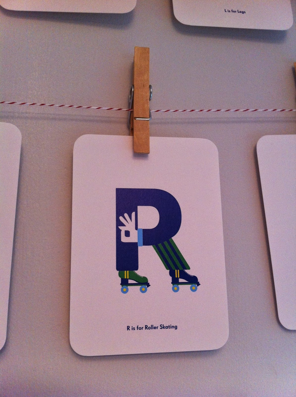 Nursery Names aphabet card R for Roller skating