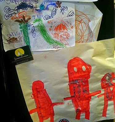 What would you save in a fire? Children's artwork on fridge