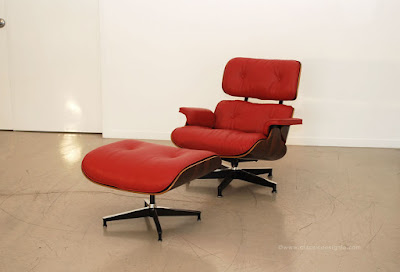 restored eames lounge chair in red leather
