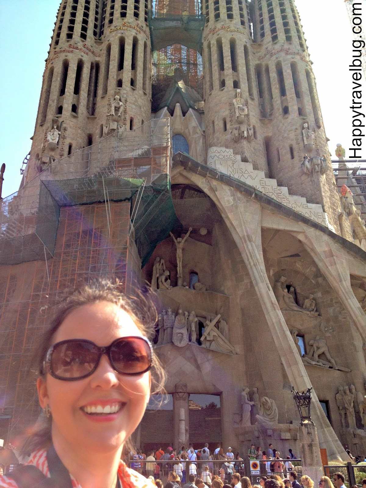 Happy travel bug at La Sagrada Familia in Barcelona, Spain