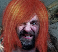 imagine a man, a beard and red diva hair
