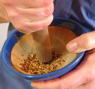 Bruce Grinding Pepper with Mortar and Pestle