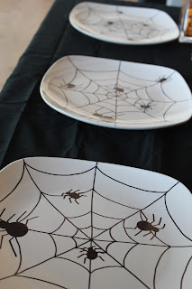 Make your own Halloween glasses and plates to decorate your dinner table.  Using this simple technique, the full moons the limit with your Halloween designs.  I chose a fun spider for my glasses and dishes that made the party a little more creepy!