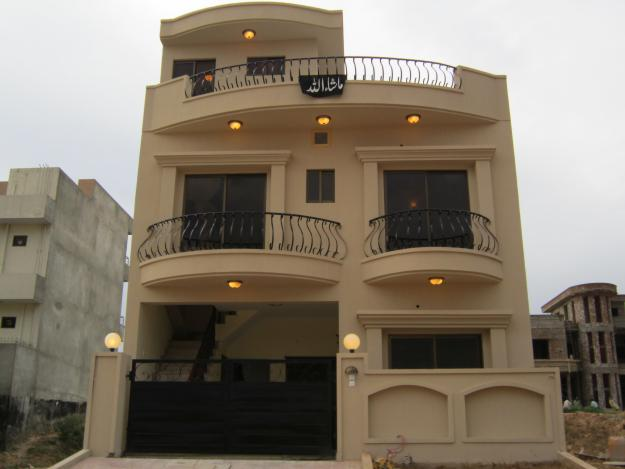 New home designs latest.: Pakistani new home designs exterior views.