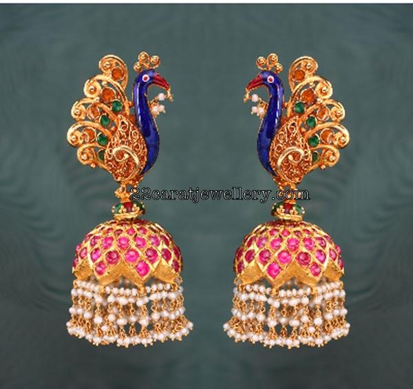 gold peacock earrings with pearlsheavy jumkas gallery