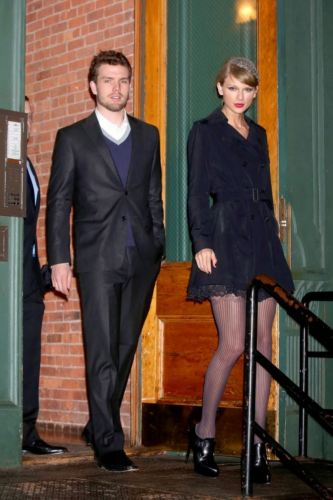 Taylor Swift sizzles in fishnet tights and a belted trench coat for outing with brother in NYC