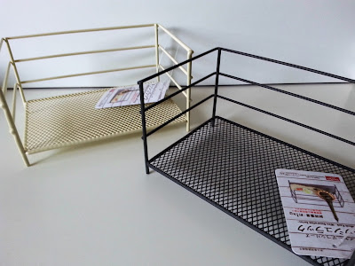 Two Daiso wire shelves, one cream, one charcoal.