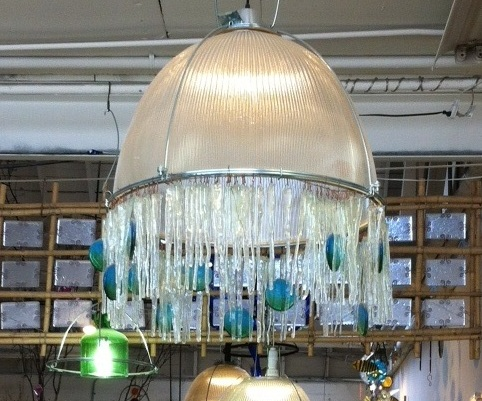 Spectacular Bedrock turned an old industrial light shade from a remodeled shopping mall into a jellyfish like chandelier