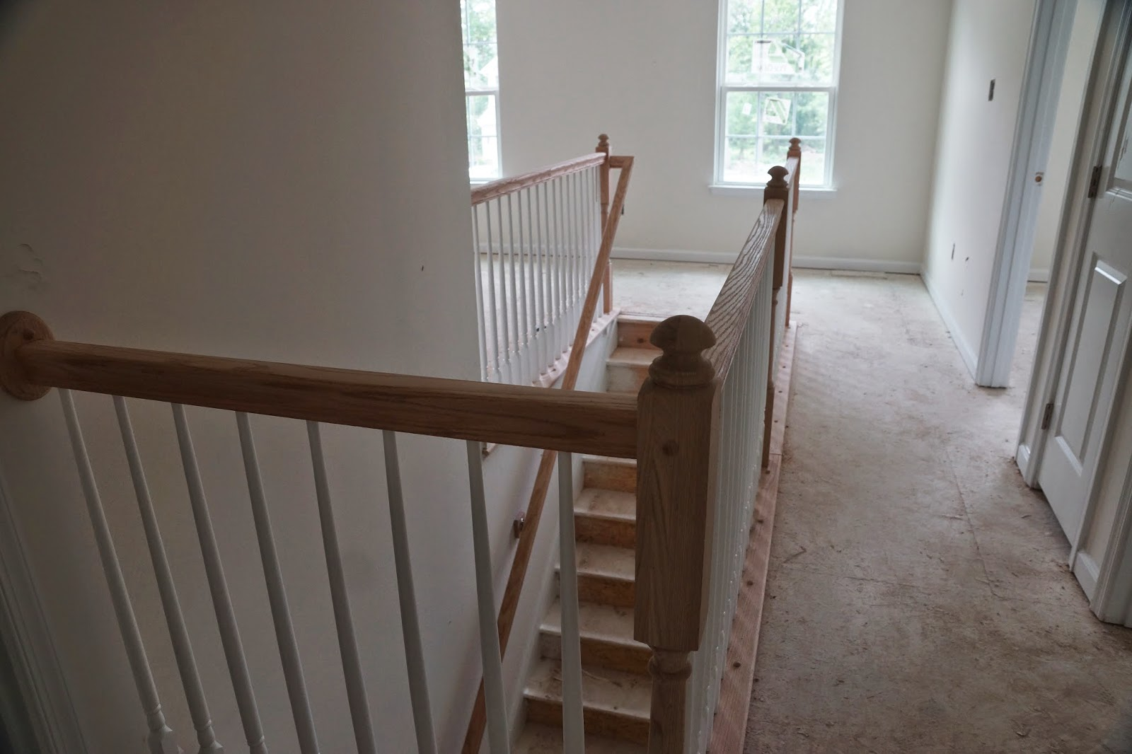 Picture of the unfinished banister on the top of the stairs as viewed from the end of the hallway