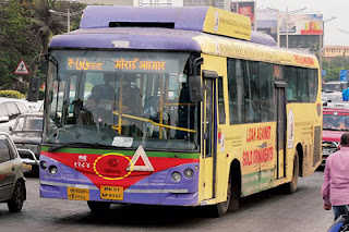 King Kong B.E.S.T AC buses ply the road in Mumbai.